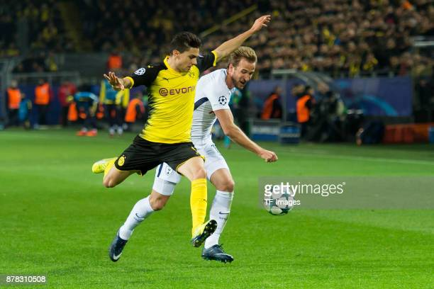 Marc Bartra of Borussia Dortmund and Christian Eriksen of Tottenham Hotspur battle for the ball during the UEFA Champions League group H match...
