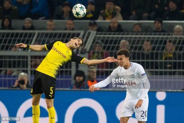 Marc Bartra of Borussia Dortmund and Dele Alli of Tottenham Hotspur battle for the ball during the UEFA Champions League group H match between...