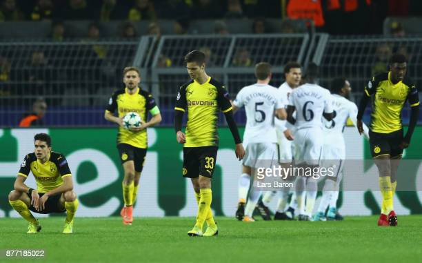 Marc Bartra of Borussia Dortmund and Julian Weigl of Borussia Dortmund looks dejected during the UEFA Champions League group H match between Borussia...
