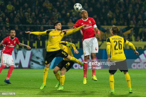 Marc Bartra of Borussia Dortmund and Luisao of Benfica battle for the ball during the UEFA Champions League Round of 16 Second Leg match between...