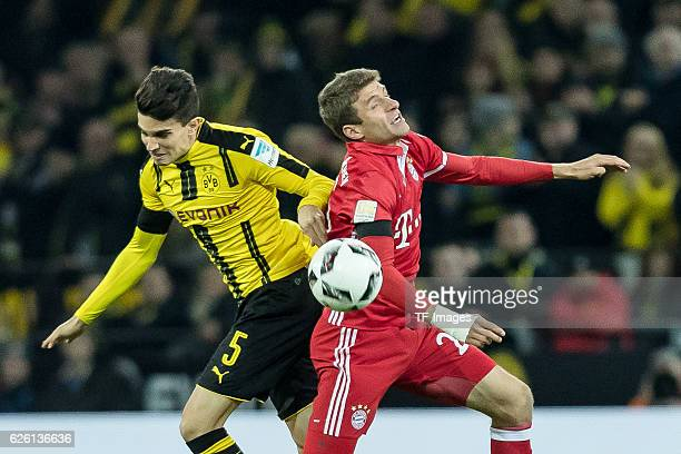 Marc Bartra of Borussia Dortmund and Thomas Mueller of Bayern Muenchen battle for the ball during the Bandesliga soccer match between BV Borussia...