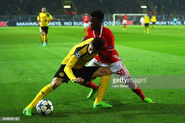 Marc Bartra of Borussia Dortmund battles for the ball with Nelson Semedo of SL Benfica during the UEFA Europa League Round of 16 first leg match...