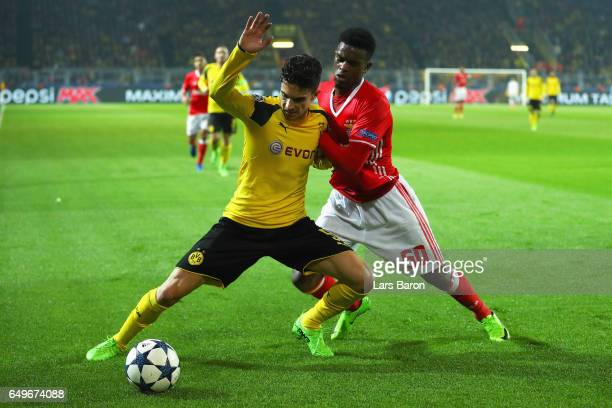 Marc Bartra of Borussia Dortmund battles for the ball with Nelson Semedo of SL Benfica during the UEFA Champions League Round of 16 second leg match...