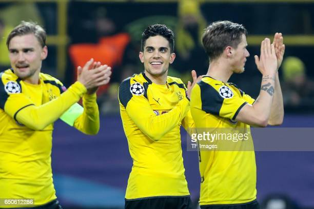 Marc Bartra of Borussia Dortmund celebrate their win after the UEFA Champions League Round of 16 Second Leg match between Borussia Dortmund and SL...
