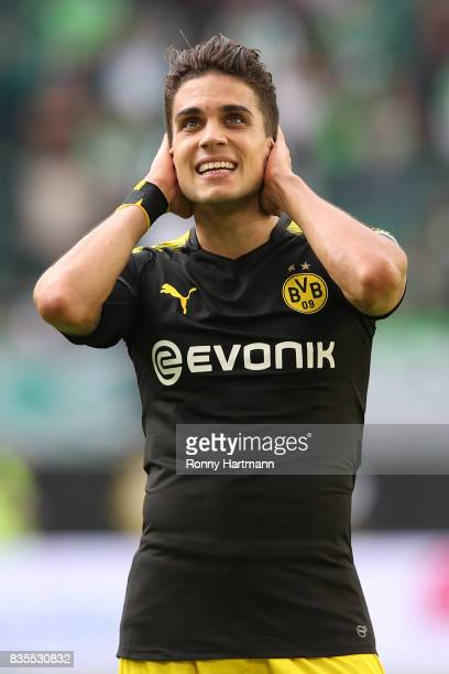 Marc Bartra of Borussia Dortmund celebrates after the Bundesliga match between VfL Wolfsburg and Borussia Dortmund at Volkswagen Arena on August 19...