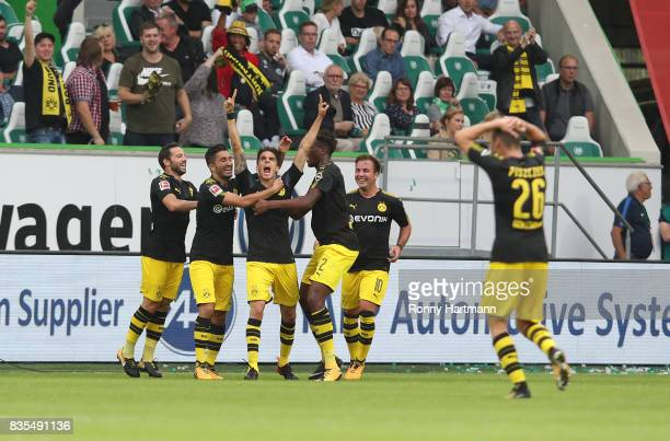 Marc Bartra of Borussia Dortmund celebrates his goal with his team mates during the Bundesliga match between VfL Wolfsburg and Borussia Dortmund at...