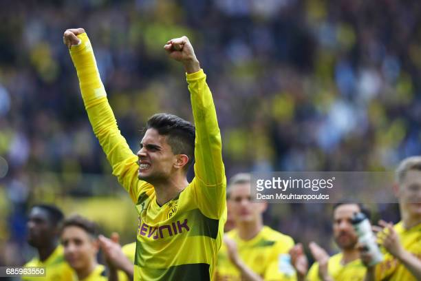 Marc Bartra of Borussia Dortmund celebrates in front of the Kop or home fans after victory in the Bundesliga match between Borussia Dortmund and...