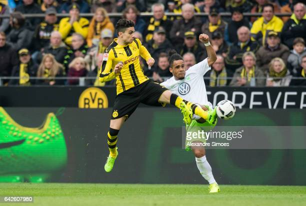 Marc Bartra of Borussia Dortmund challenges Daniel Didavi of VfL Wolfsburg during the Bundesliga match between Borussia Dortmund and VfL Wolfsburg at...