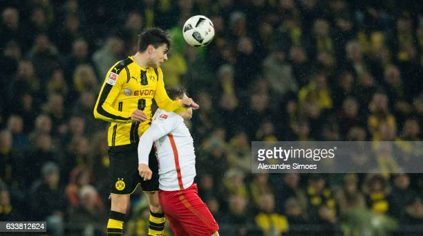 Marc Bartra of Borussia Dortmund challenges Dominik Kaiser of RB Leipzig during the Bundesliga match between Borussia Dortmund and RB Leipzig at...