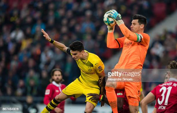 Marc Bartra of Borussia Dortmund challenges goal keeper Philipp Tschauner of Hannover 96 during the Bundesliga match between Hannover 96 and Borussia...