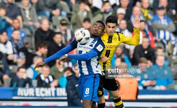 Marc Bartra of Borussia Dortmund challenges Salomon Kalou of Hertha BSC during the Bundesliga match between Hertha BSC and Borussia Dortmund at the...