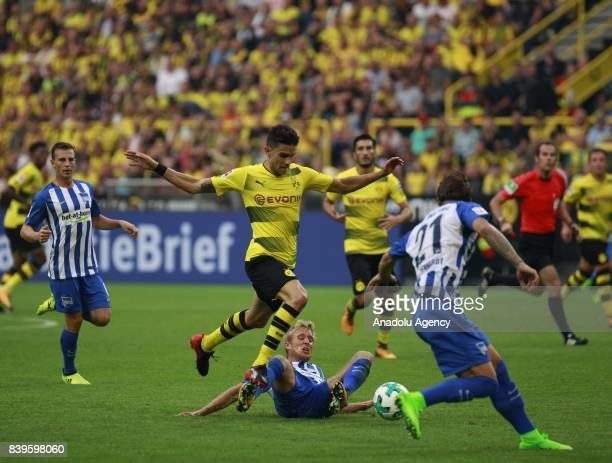 Marc Bartra of Borussia Dortmund challenges with Per Skjelbred of Hertha BSC Berlin during the Bundesliga soccer match between Borussia Dortmund and...