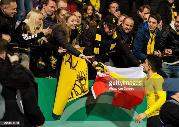 Marc Bartra of Borussia Dortmund gives his jersey to a fan after the finale whistle during the DFB Cup Quarter Final match between Sportfreunde Lotte...