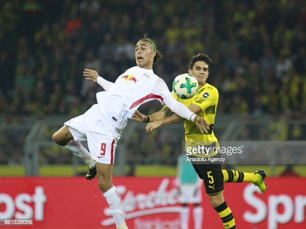 Marc Bartra of Borussia Dortmund in action against Yussuf Poulsen of Rasenballsport Leipzig during the Bundesliga soccer match between Borussia...