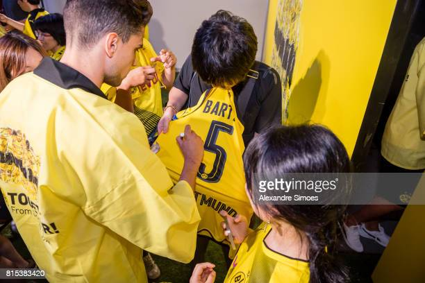 Marc Bartra of Borussia Dortmund is giving autographs to the fans during the KAMO activity event at the PUMA Brand Center Tokyo on July 16 2017 in...