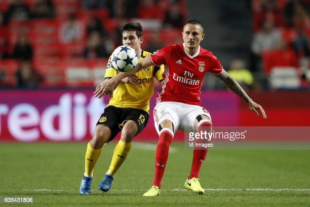Marc Bartra of Borussia Dortmund Ljubomir Fejsa of SL Benficaduring the UEFA Champions League round of 16 match between SL Benfica and Borussia...