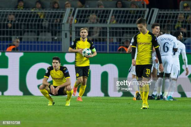 Marc Bartra of Borussia Dortmund Marcel Schmelzer of Borussia Dortmund and Julian Weigl of Borussia Dortmund look dejected during the UEFA Champions...