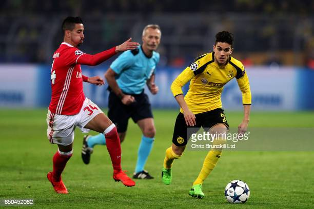 Marc Bartra of Borussia Dortmund tangles with Andre Almeida of SL Benfica during the UEFA Champions League Round of 16 second leg match between...