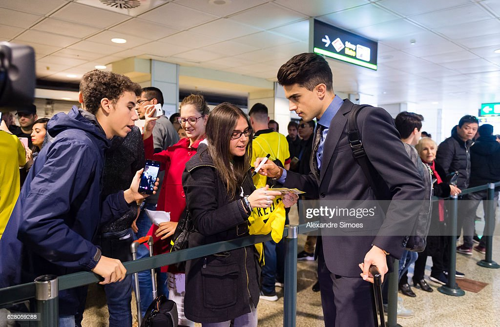 Marc Bartra of Borussia Dortmund together with fans at the airport prior to the Champions League match between Real Madrid CF and Borussia Dortmund at Estadio Santiago Bernabeu on December 06, 2016 in Madrid, Spain.