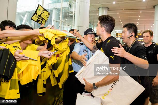 Marc Bartra of Borussia Dortmund together with the chinese fans which are welcoming the team at the airport during the Borussia Dortmund Summer Tour...