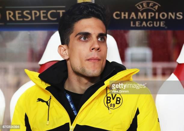 Marc Bartra of Borussia Dortmund who was injured in last weeks bus bombing sits on the bench before the UEFA Champions League Quarter Final second...