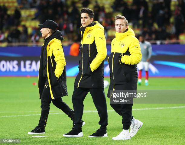 Marc Bartra of Borussia Dortmund who was injured in last weeks bus bombing walks onto the pitch before the UEFA Champions League Quarter Final second...