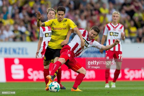 Marc Bartra of Dortmund and Benjamin Baier of Essen battle for the ball during the preseason friendly match between RotWeiss Essen and Borussia...
