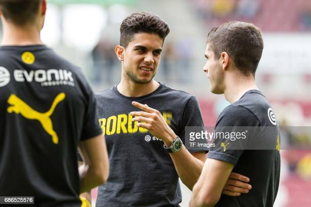 Marc Bartra of Dortmund and Christian Pulisic of Dortmund looks on during the Bundesliga match between FC Augsburg and Borussia Dortmund at the...