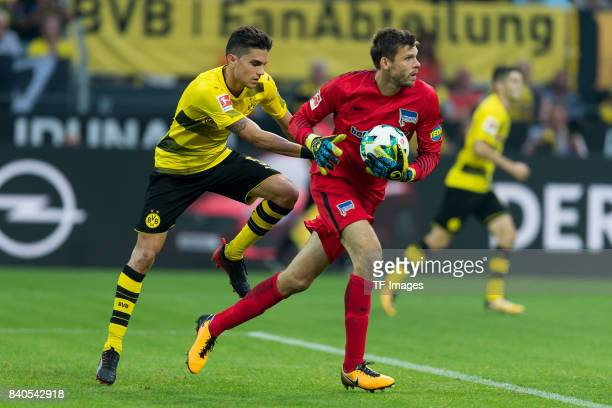 Marc Bartra of Dortmund and Goalkeeper Rune Jarstein of Hertha BSC Berlin battle for the ball during the Bundesliga match between Borussia Dortmund...
