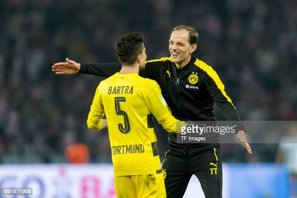 Marc Bartra of Dortmund and Head coach Thomas Tuchel of Dortmund celebrates after winning the DFB Cup final match between Eintracht Frankfurt and...