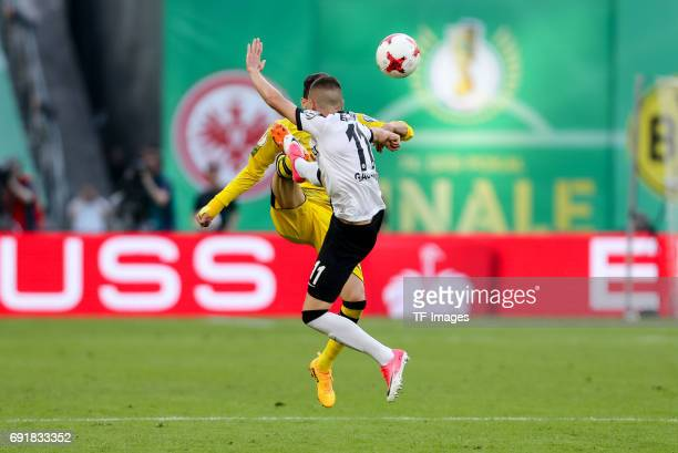 Marc Bartra of Dortmund and Mijat Gacinovic of Frankfurt battle for the ball during the DFB Cup final match between Eintracht Frankfurt and Borussia...