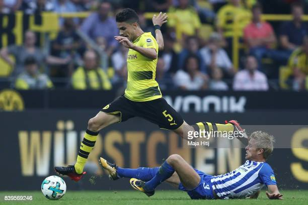 Marc Bartra of Dortmund and Per Ciljan Skjelbred of Berlin during the Bundesliga match between Borussia Dortmund and Hertha BSC at Signal Iduna Park...