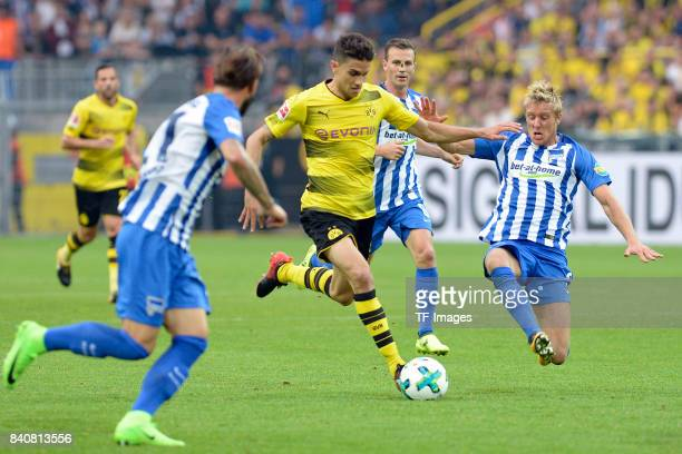 Marc Bartra of Dortmund and Per Ciljan Skjelbred of Hertha BSC Berlin battle for the ball during the Bundesliga match between Borussia Dortmund and...