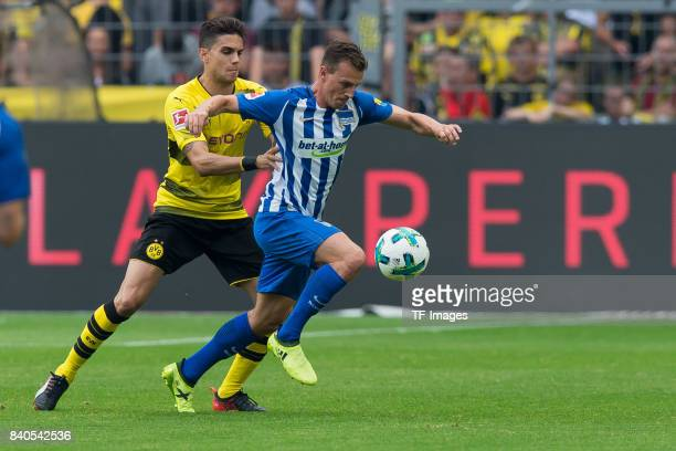Marc Bartra of Dortmund and Vladimir Darida of Hertha BSC Berlin battle for the ball during the Bundesliga match between Borussia Dortmund and Hertha...