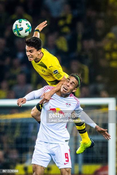 Marc Bartra of Dortmund and Yussuf Poulsen of Leipzig head the ball during the Bundesliga match between Borussia Dortmund and RB Leipzig at Signal...