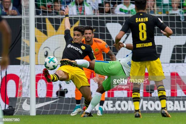 Marc Bartra of Dortmund battle for the ball during to the Bundesliga match between VfL Wolfsburg and Borussia Dortmund at Volkswagen Arena on August...