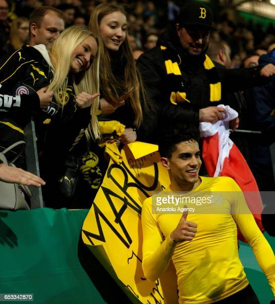 Marc Bartra of Dortmund celebrates his team's victory after the DFB Cup quarter final between Sportfreunde Lotte and Borussia Dortmund at Bremer...