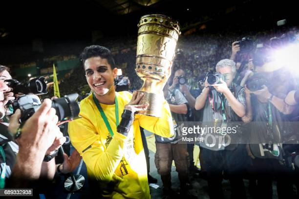 Marc Bartra of Dortmund celebrates with a trophy after winning the DFB Cup final match between Eintracht Frankfurt and Borussia Dortmund at...