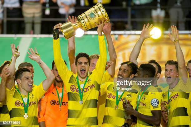 Marc Bartra of Dortmund celebrates with the trophy after winning the DFB Cup final match between Eintracht Frankfurt and Borussia Dortmund at...