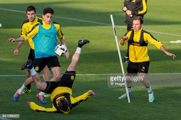 Marc Bartra of Dortmund Felix Passlack of Dortmund and Mario Goetze of Dortmund battle for the ball during the fifth day of the training camp in...