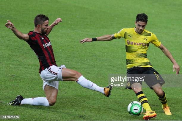 Marc Bartra of Dortmund in action against Fabio Borini of AC Milan during the 2017 International Champions Cup football match between AC Milan and...