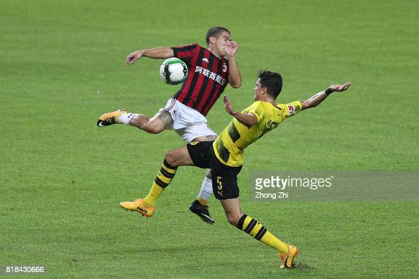 Marc Bartra of Dortmund in action against Jose Mauri of AC Milan during the 2017 International Champions Cup football match between AC Milan and...