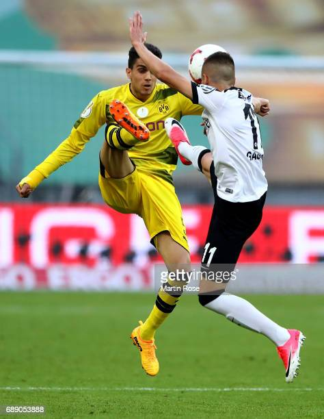 Marc Bartra of Dortmund is challenged by Mijat Gacinovic of Frankfurt during the DFB Cup final match between Eintracht Frankfurt and Borussia...