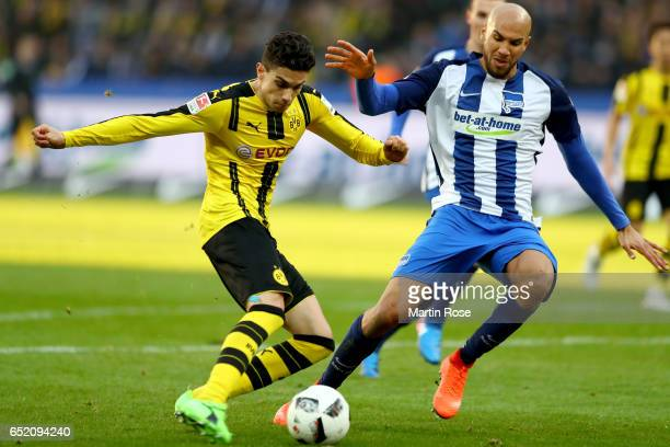 Marc Bartra of Dortmund is challenged John Anthony Brooks of Berlin during the Bundesliga match between Hertha BSC and Borussia Dortmund at...