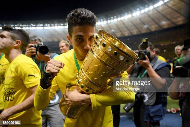 Marc Bartra of Dortmund lifts the trophy after winning the DFB Cup Final 2017 between Eintracht Frankfurt and Borussia Dortmund at Olympiastadion on...