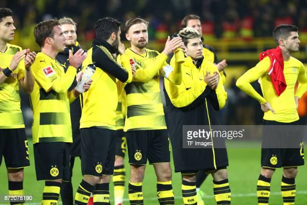 Marc Bartra of Dortmund Mario Goetze of Dortmund Nuri Sahin of Dortmund and Marcel Schmelzer of Dortmund Raphael Guerreiro of Dortmund and Christian...