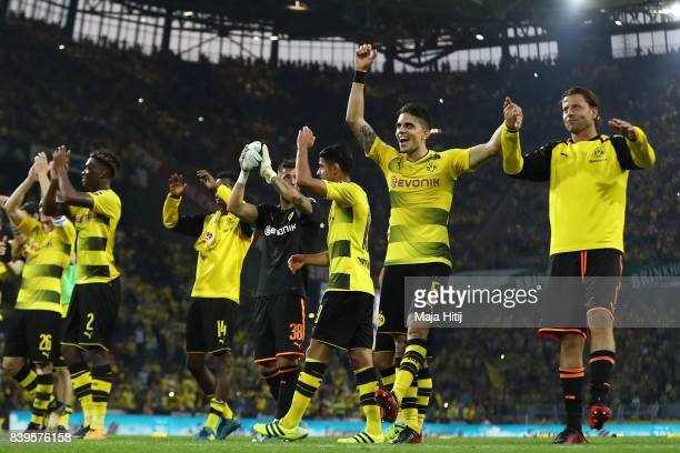 Marc Bartra of Dortmund Roman Weidenfeller of Dortmund and players of Dortmund celebrate with their fans after the Bundesliga match between Borussia...