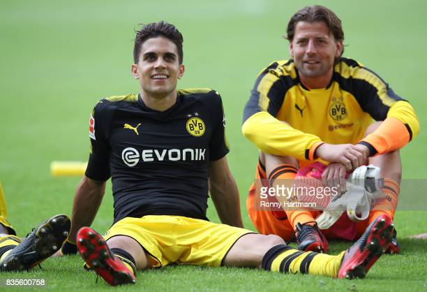 Marc Bartra of Dortmund sits on the pitch next to goalkeeper Roman Weidenfeller of Dortmund after the Bundesliga match between VfL Wolfsburg and...