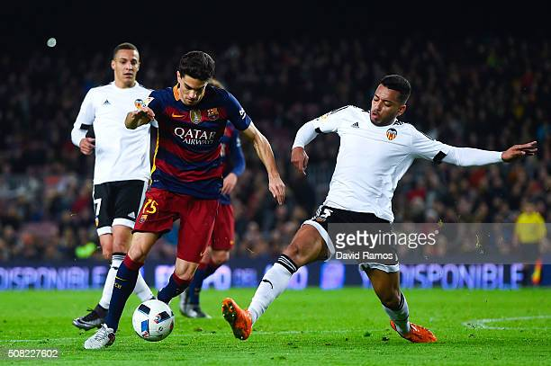 Marc Bartra of FC Barcelona competes for the ball with Ruben Vezo of Valencia CF during the Copa del Rey Semi Final first leg match between FC...