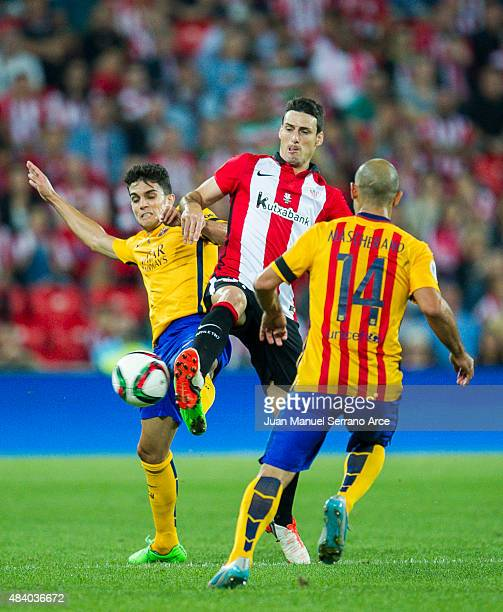 Marc Bartra of FC Barcelona duels for the ball withÊAritz Aduriz of Athletic Club during the Super Cup first leg match between of Athletic Club and...